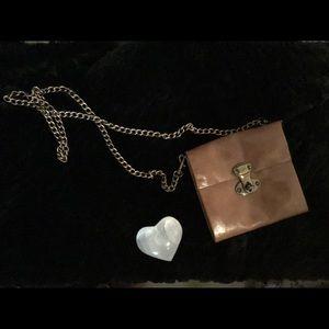 Cross body miniature purse.